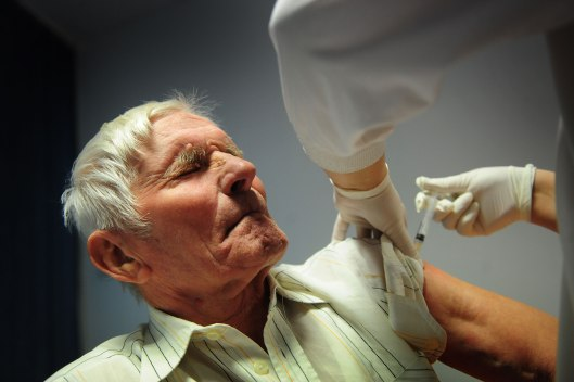 A Romanian gets vaccinated against swine